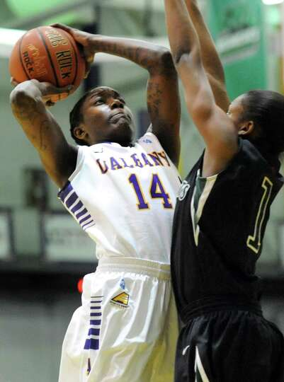UAlbany's Tammy Phillip, left, aims for the hoop as Binghamton's Kandace Newry defends during the th