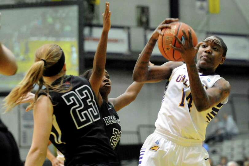 UAlbany's Tammy Phillip, right, hangs on to a rebound during the their first-round basketball game a