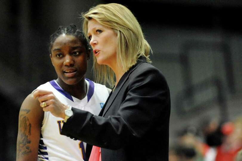 UAlbany's Tammy Phillip, left, listens to coach Katie Abrahamson-Henderson during the their first-ro