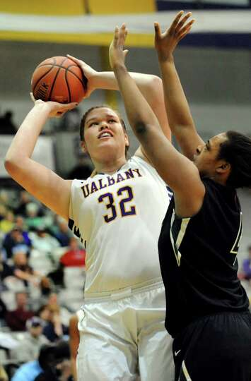 UAlbany's Megan Craig, left, looks to shoot as Binghamton's Morgan Murphy defends during their first