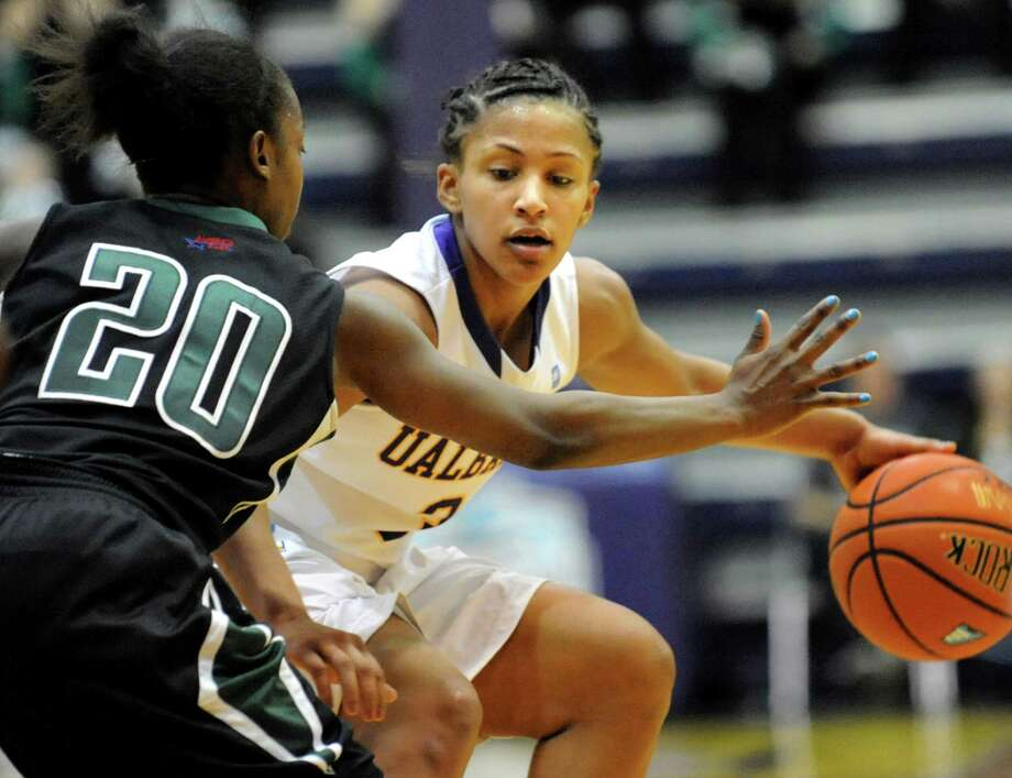 UAlbany's Margarita Rosario, right, drives up court as Binghamton's Vaneeshia Paulk defends during their first-round basketball game in the America East Tournament on Friday, March 7, 2014, at SEFCU Arena in Albany, N.Y. (Cindy Schultz / Times Union) Photo: Cindy Schultz / 00026024A