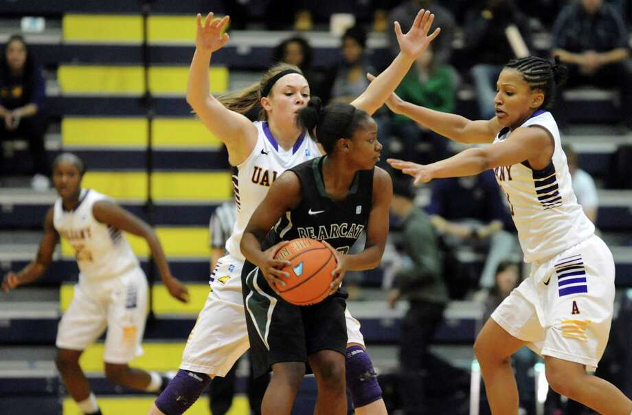 UAlbany's Sarah Royals, center, and Margarita Rosario, right, pressure Binghamton's Vaneeshia Paulk during their first-round basketball game in the America East Tournament on Friday, March 7, 2014, at SEFCU Arena in Albany, N.Y. (Cindy Schultz / Times Union) Photo: Cindy Schultz / 00026024A