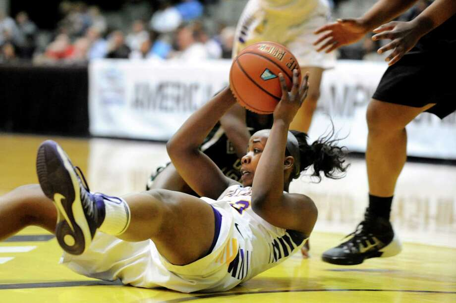 UAlbany's Imani Tate tries to pass the ball after a scramble on the court during their first-round basketball game against Binghamton in the America East Tournament on Friday, March 7, 2014, at SEFCU Arena in Albany, N.Y. (Cindy Schultz / Times Union) Photo: Cindy Schultz / 00026024A