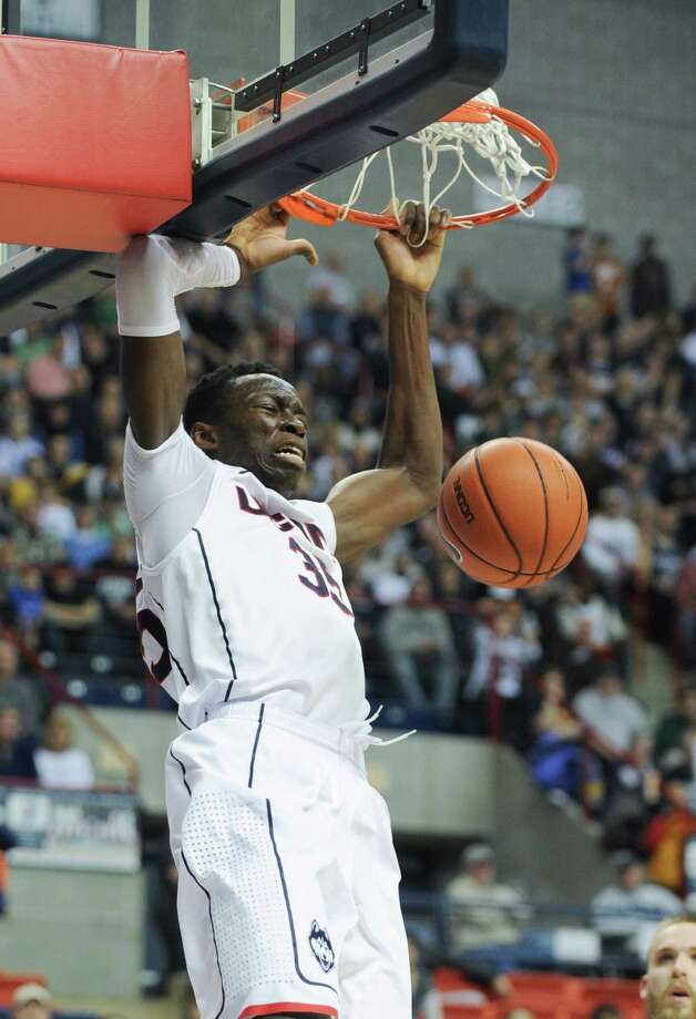 Connecticut's Amida Brimah (35), dunks the ball during the second half of an NCAA college basketball game against Central Florida Saturday, Jan. 11,  2014, in Storrs, Conn. (AP Photo/Gretchen Ertl) Photo: Gretchen Ertl, Associated Press / Associated Press