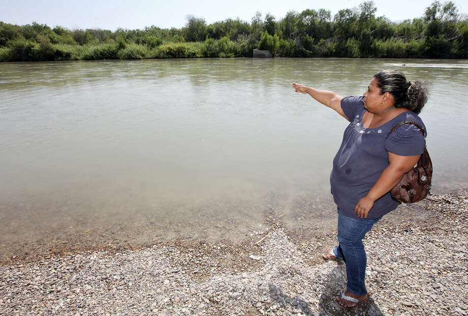 Nora Isabel Lam Gallegos talks about the shooting death of her husband, Guillermo Arévalo Pedroza, in Nuevo Laredo, Mexico. Photo: San Antonio Express-News / File Photo / © 2012 San Antonio Express-News