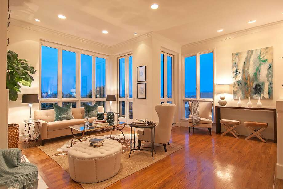 Terrace off the great room overlooks the bay. Photo: Luxe Home Tours
