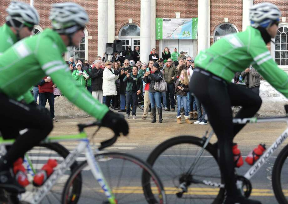 "The crowd cheers as Team 26 cyclists arrive for the official send-off at Edmond Town Hall in Newtown, Conn. Saturday, March 8, 2014.  Team 26 will ride to Washington, D.C. over the course of four days to push for ""common sense"" gun legislation, making stops in Ridgefield, Greenwich, Harlem, N.Y., Morristown, N.J., Doylestown, Pa. and Baltimore, Md. along the way.  The send-off featured several speakers including Team 26 founder Monte Frank and Mark Bardon, who lost his son, Daniel, in the Sandy Hook Elementary School shooting. U.S. Rep. Elizabeth Esty and U.S. Senator Richard Blumenthal also spoke at the event, wishing good luck to the 26 riders. Photo: Tyler Sizemore / The News-Times"