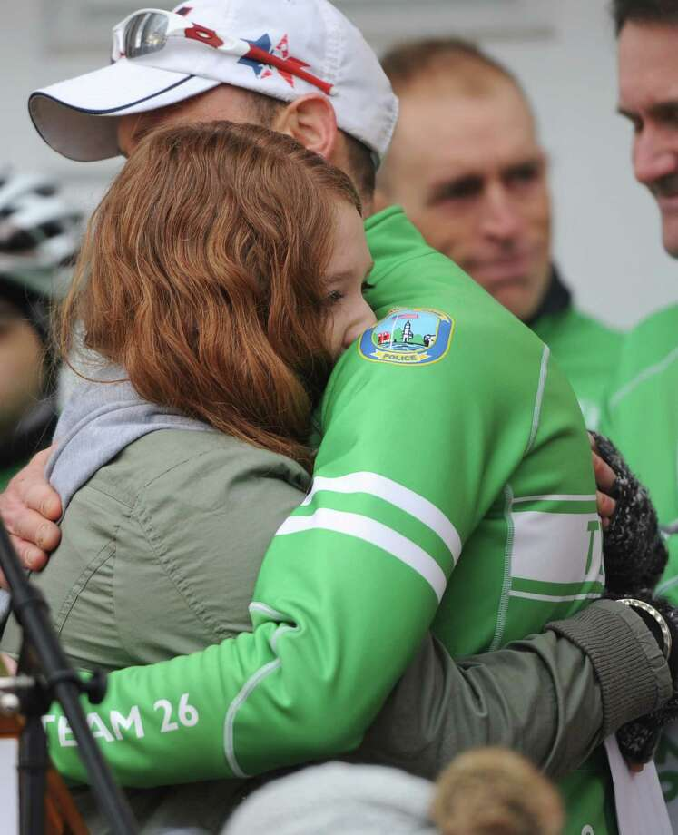"Newtown student activist Sarah Clements hugs Team 26 founder Monte Frank after speaking at the Team 26 cyclist send-off at Edmond Town Hall in Newtown, Conn. Saturday, March 8, 2014.  Team 26 will ride to Washington, D.C. over the course of four days to push for ""common sense"" gun legislation, making stops in Ridgefield, Greenwich, Harlem, N.Y., Morristown, N.J., Doylestown, Pa. and Baltimore, Md. along the way.  The send-off featured several speakers including Team 26 founder Monte Frank and Mark Bardon, who lost his son, Daniel, in the Sandy Hook Elementary School shooting. U.S. Rep. Elizabeth Esty and U.S. Senator Richard Blumenthal also spoke at the event, wishing good luck to the 26 riders. Photo: Tyler Sizemore / The News-Times"