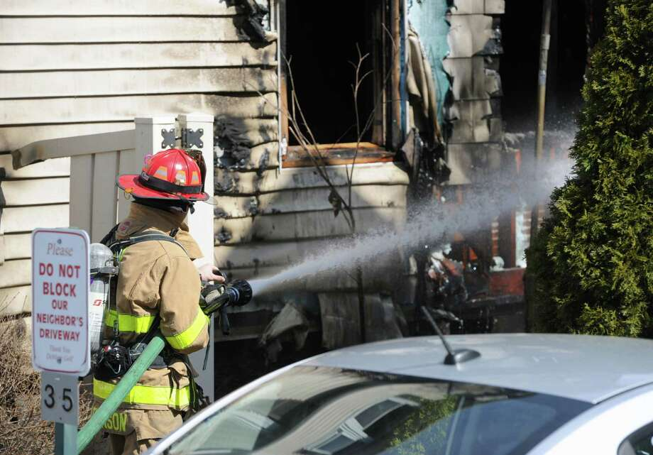 The aftermath of a house fire at 35 Chapel Street in Greenwich, Conn., Saturday morning, March 8, 2014. Greenwich fire offficials on the scene said that no one was injured in the fire. Photo: Bob Luckey / Greenwich Time