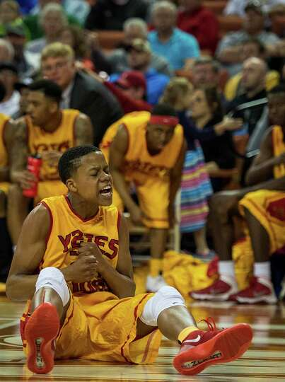 Yates guard Jacob Young reacts after being called for a foul during the first half.