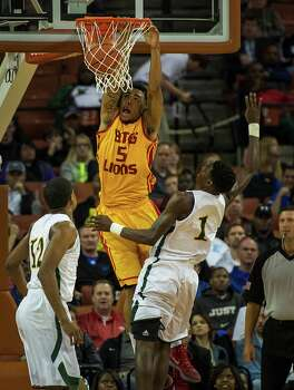 Yates' JC Washington (5) dunks the ball past Dallas Madison's Johnathan Turner. Photo: Smiley N. Pool, Houston Chronicle / © 2014  Houston Chronicle