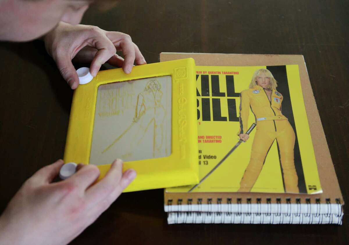 Etch-a-Sketch artist Bryan Madden creates a sketch of the