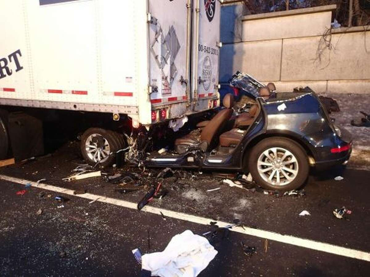 A 34-year-old New Haven man was seriously injured on Saturday, March 8, 2014 after his Audi SUV slammed into a tractor-trailer truck on northbound I-95 in Greenwich. It took Greenwich firefighters more than 90 minutes to extricate Tavonn Jerkins from the crushed vehicle. Photo by Greenwich Professional Firefighters.