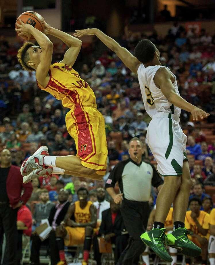Yates guard Milton Jackson (0) puts up a shot over Dallas Madison guard Admon Gilder. Photo: Smiley N. Pool, Houston Chronicle / © 2014  Houston Chronicle