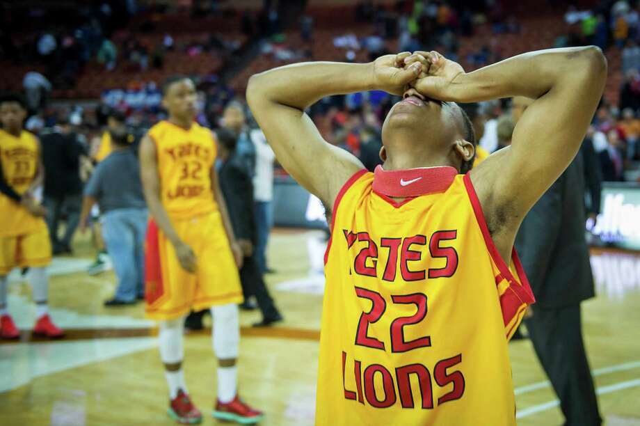 Yates guard Artreal Jones reacts after a loss to Dallas Madison. Photo: Smiley N. Pool, Houston Chronicle / © 2014  Houston Chronicle
