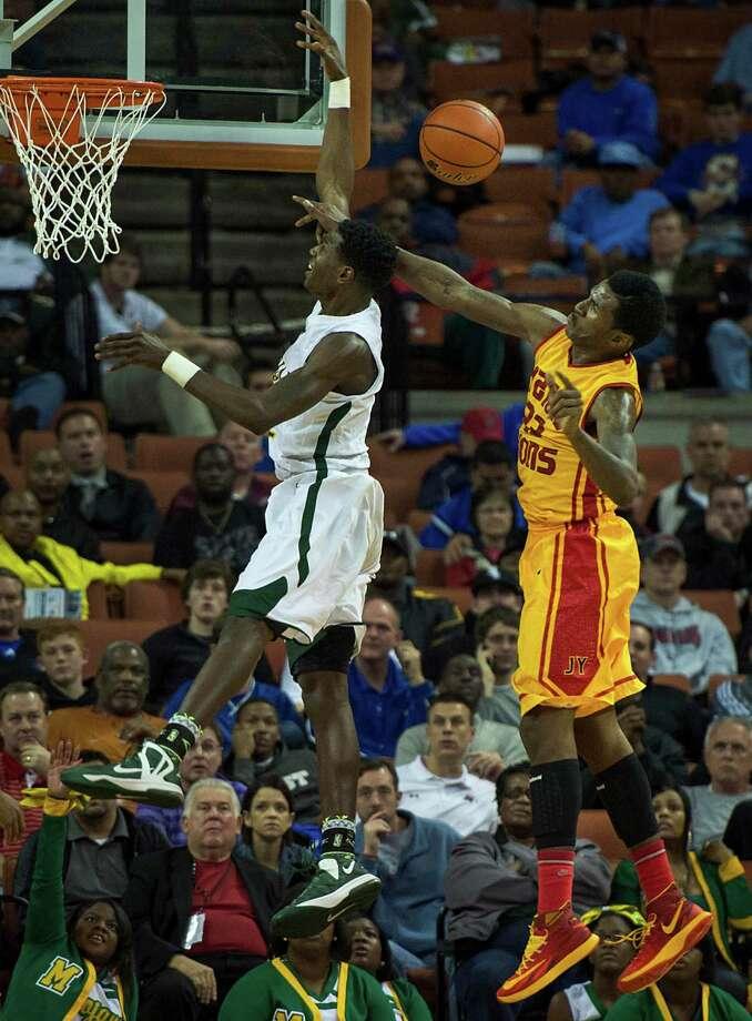 Yates' Melvin Swift (23) blocks a shot by Madison's Johnathan Turner. Photo: Smiley N. Pool, Houston Chronicle / © 2014  Houston Chronicle