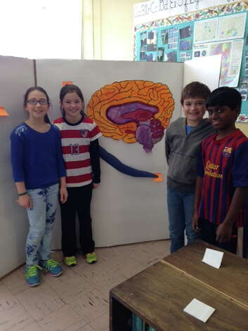 Brown School students in Schenectady prepare for their Brain Awareness Week program last week. The students are from Ms. McGann's fourth-grade class and include, fromm left, Mia Achcet, Eva Sterthous, Sam Rodick, Arjun Govindarajan. (Submitted by Susan Bardack)