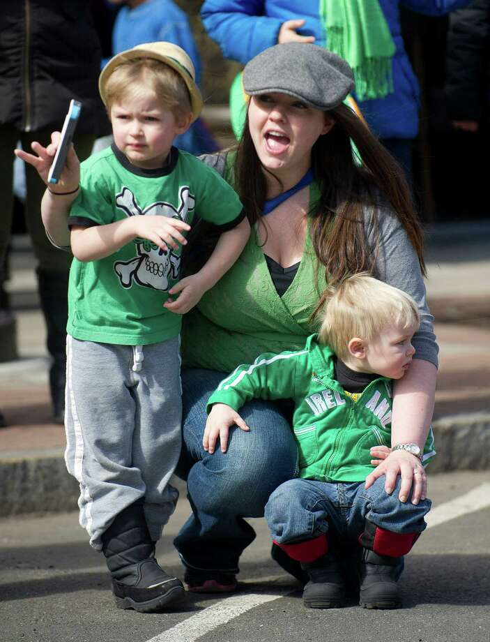 Claire Garbera watches the 19th annual St. Patrick's Day parade in Stamford, Conn., with her sons John, 3, left, and Mark, 1, right, on Saturday, March 8, 2014. Photo: Lindsay Perry / Stamford Advocate