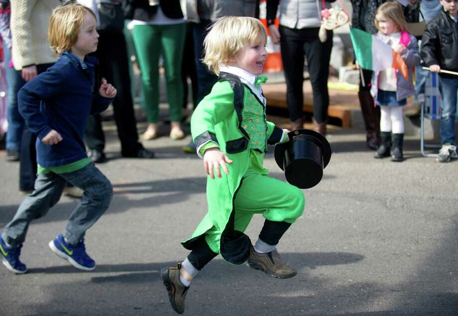 A boy dressed as a leprechaun runs in the 19th annual St. Patrick's Day parade in Stamford, Conn., on Saturday, March 8, 2014. Photo: Lindsay Perry / Stamford Advocate