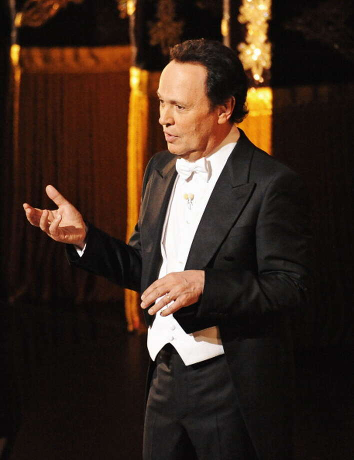 HOLLYWOOD, CA - FEBRUARY 26:  Host Billy Crystal speaks onstage during the 84th Annual Academy Awards held at the Hollywood & Highland Center on February 26, 2012 in Hollywood, California.  (Photo by Mark Davis/WireImage) Photo: Mark Davis, WireImage / 2012 WireImage