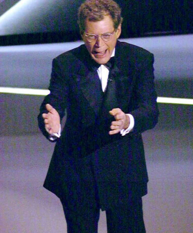 "LOS ANGELES, CA - MARCH 27:  US television personality David Letterman delivers his opening monologue as he hosts the 67th annual Academy Awards in Los Angeles 27 March. Letterman, who stars in the ""Late Show with David Letterman"" on CBS-TV, is the third Academy Awards host in as many years. AFP PHOTO  (Photo credit should read DON EMMERT/AFP/Getty Images) Photo: DON EMMERT, AFP/Getty Images / AFP"