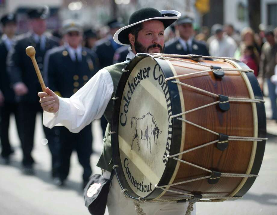 The Colchester Continental Fife and Drum Corps performs during the 19th annual St. Patrick's Day parade in Stamford, Conn., on Saturday, March 8, 2014. Photo: Lindsay Perry / Stamford Advocate