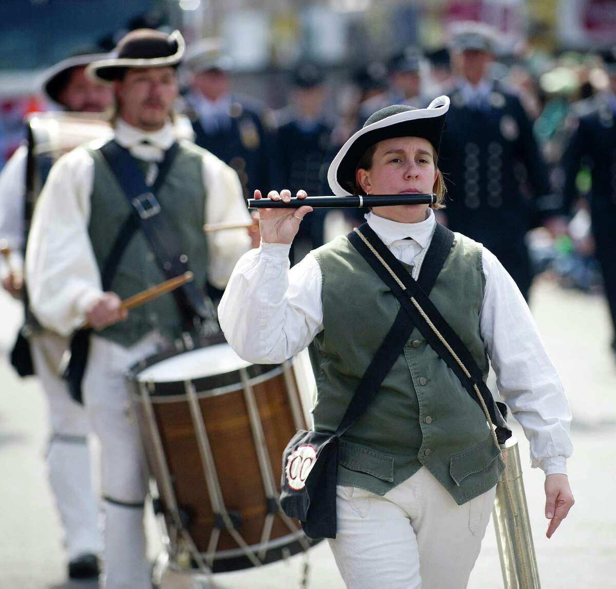 The Colchester Continental Fife and Drum Corps performs during the 19th annual St. Patrick's Day parade in Stamford, Conn., on Saturday, March 8, 2014.