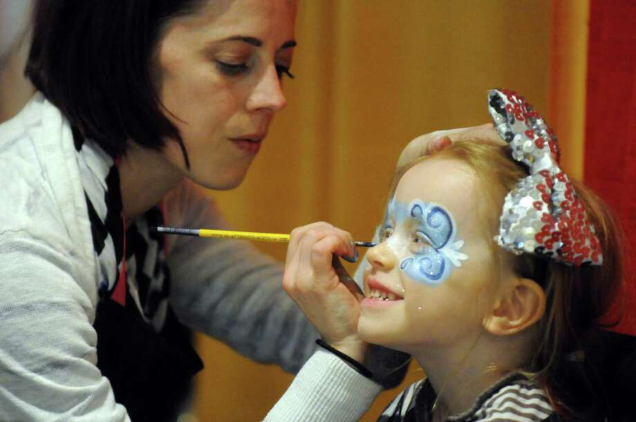 Madailein O'Sullivan of Albany gets her face painted by Jo-Michelle Scott of JoJo's Fabulous Faces during the ninth annual Hannaford Kidz Expo at the Empire State Plaza on Saturday, March 8, 2014 in Albany, N.Y. (Michael P. Farrell/Times Union) Photo: Michael P. Farrell / 00026059A
