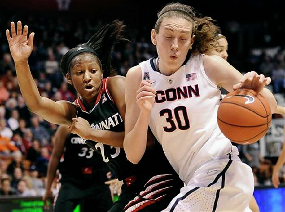 Connecticut's Breanna  Stewart, right, drives around Cincinnati's Jasmine Whitfield, left,  during the second half of an NCAA college basketball game in the  quarterfinals of the American Athletic Conference women's basketball  tournament, Saturday, March 8, 2014, in Uncasville, Conn. Connecticut  won 72-42. (AP Photo/Jessica Hill)