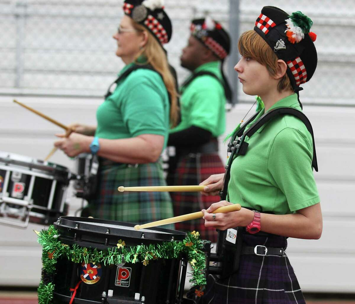 Drummer Caitlin Spence of San Antonio Pipes & Drums marches in the St. Patrick's Day Parade at the University of the Incarnate Word on Saturday, Mar. 8, 2014.