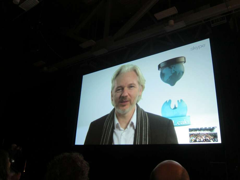 Fugitive WikiLeaks founder Julian Assange speaks via Skype at the South by Southwest Interactive conference in Austin, Texas. Photo: Barbara Ortutay, Associated Press