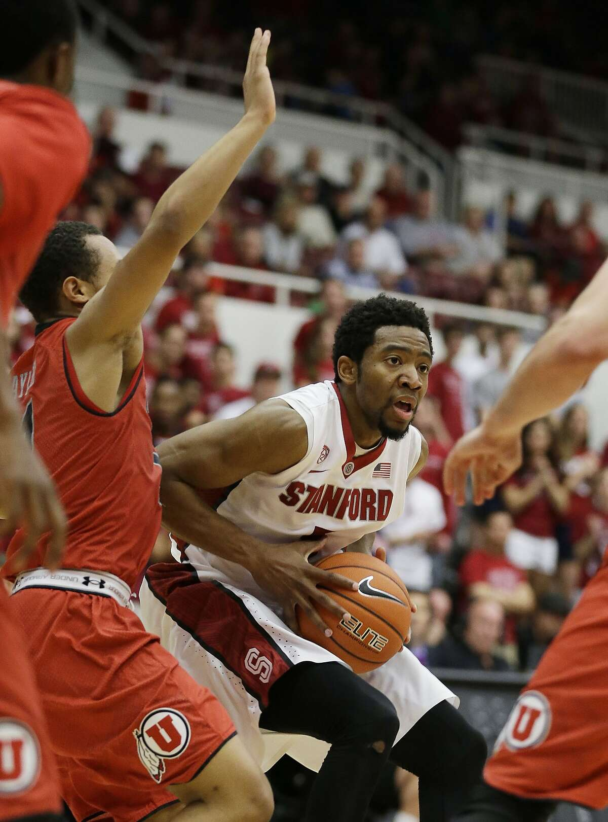 Stanford guard Chasson Randle, right, goes to the basket as Utah guard Brandon Taylor, left, looks on during the second half of their NCAA college basketball game Saturday, March 8, 2014, in Stanford, Calif. Stanford won the game 61-60. (AP Photo/Eric Risberg)