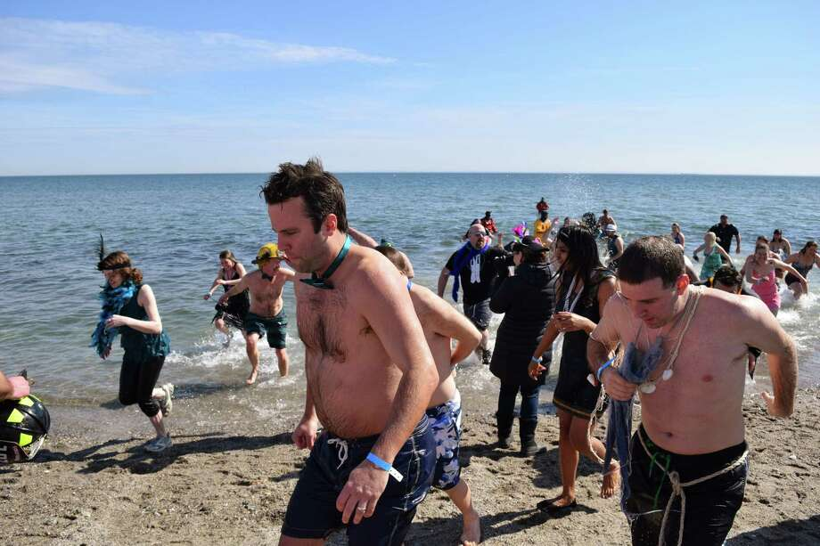 Luckily it was nice and warm today down at Compo Beach in Westport as hundreds came out for the annual Penguin Plunge in support of the Special Olympics. Were you SEEN frolicking about and jumping into Long Island Sound? 3/8/2014 Photo: Todd Tracy / Hearst Connecticut Media Group