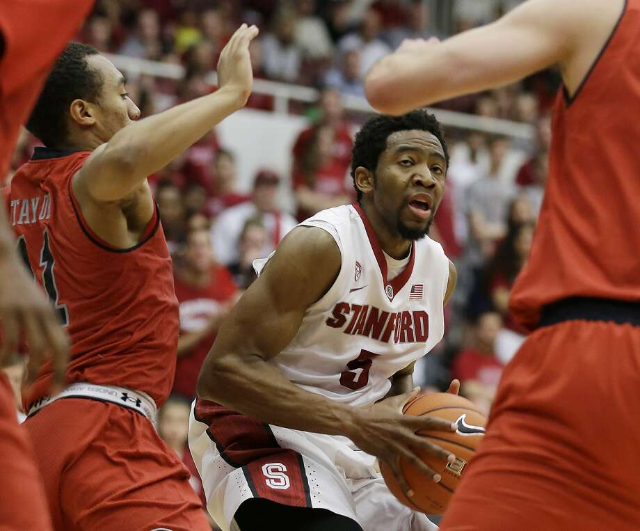 Utah guard Brandon Taylor (left) tries to defend Stanford's Chasson Randle, who had 22 points. Photo: Eric Risberg, Associated Press