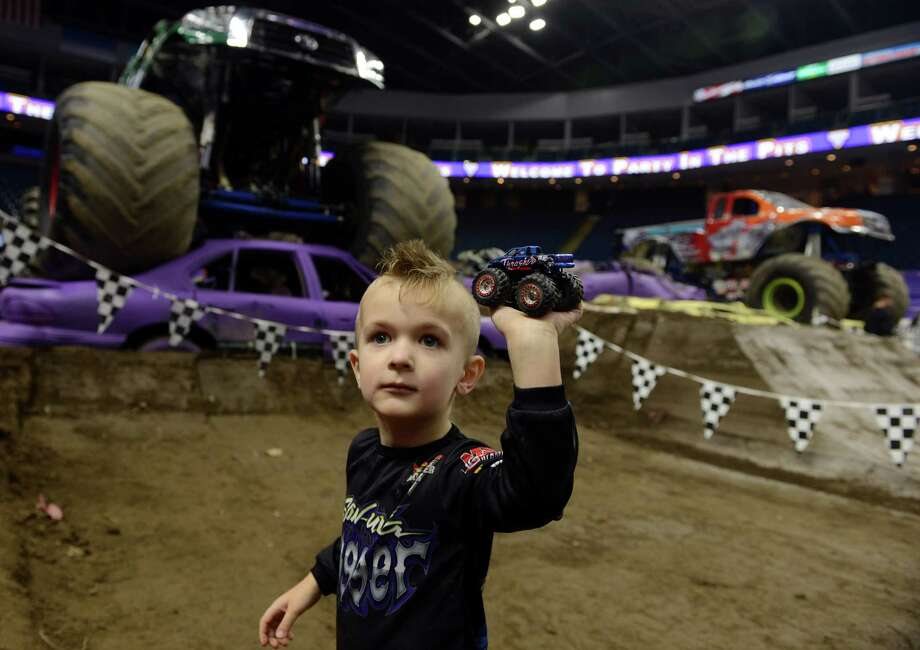 Three-year-old Maks Dul, of Norwalk, holds up his Thrasher truck during the Monster Jam pit party Saturday, Mar. 8, 2014, at the Webster Bank Arena in Bridgeport, Conn. The last show is Sunday, March 9 at 2 p.m. proceeded by the pit party at 11 a.m. Photo: Autumn Driscoll / Connecticut Post