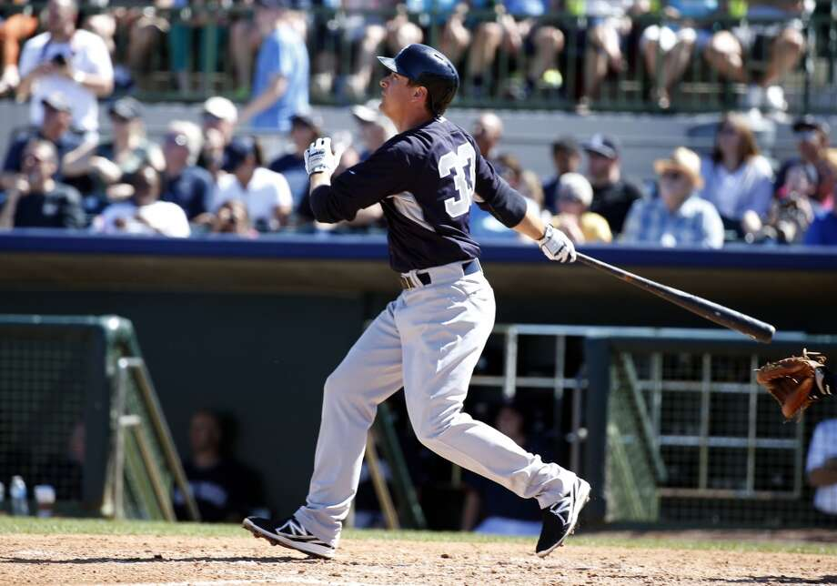 Kelly Johnson of the Yankees hits a two-run home run against the Astros. Photo: Alex Brandon, Associated Press