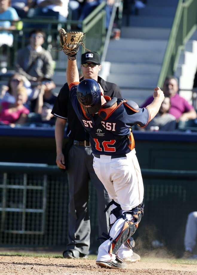 Astros catcher Max Stassi catches a pop up against the Yankees. Photo: Alex Brandon, Associated Press