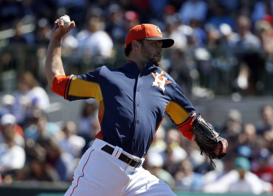 Astros pitcher Jarred Cosart delivers a throw to the Yankees. Photo: Alex Brandon, Associated Press