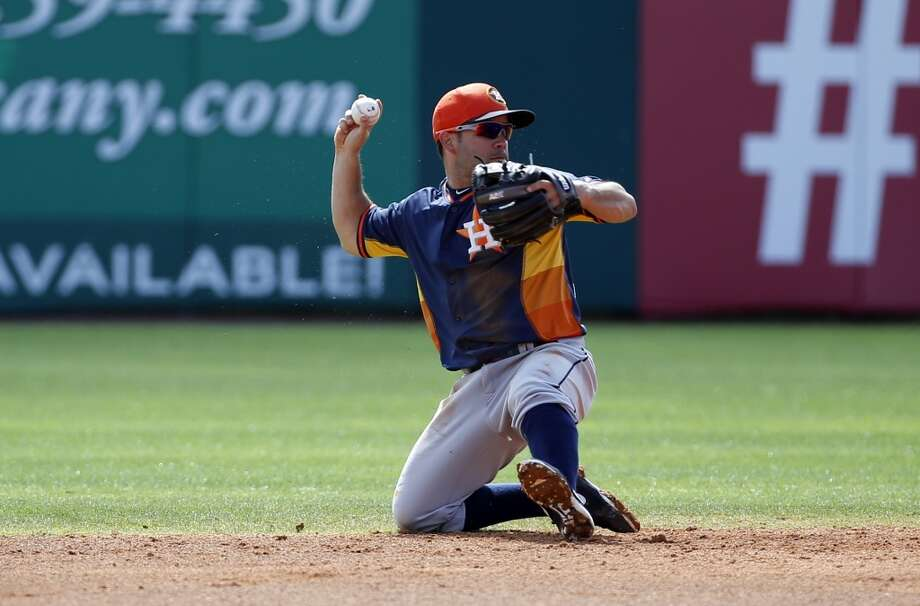 Astros second baseman Jose Altuve throws to first from his knee. Photo: Alex Brandon, Associated Press