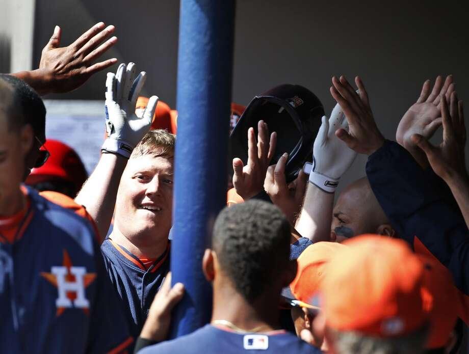 Marc Krauss, left, celebrates his solo home run. Photo: Alex Brandon, Associated Press