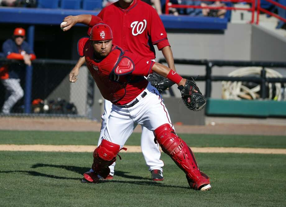 Nationals catcher Jhonatan Solano prepares to throw to first for the out after fielding a bunt by Marwin Gonzalez. Photo: Alex Brandon, Associated Press