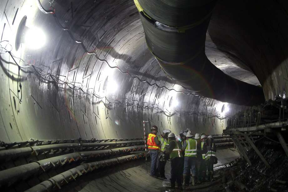 Visitors get a peek at the progress in the northbound tunnel of Muni's Central Subway project in San Francisco. Photo: Paul Chinn, The Chronicle