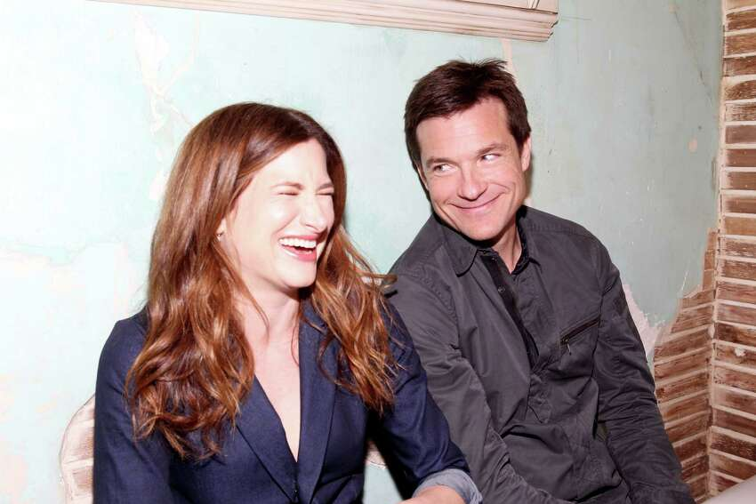 AUSTIN, TX - MARCH 08: Actors Kathryn Hahn (L) and Jason Bateman attend Funny Or Die Clubhouse + Facebook Pop-Up HQ @ SXSW - Day 1 on March 8, 2014 in Austin, Texas.
