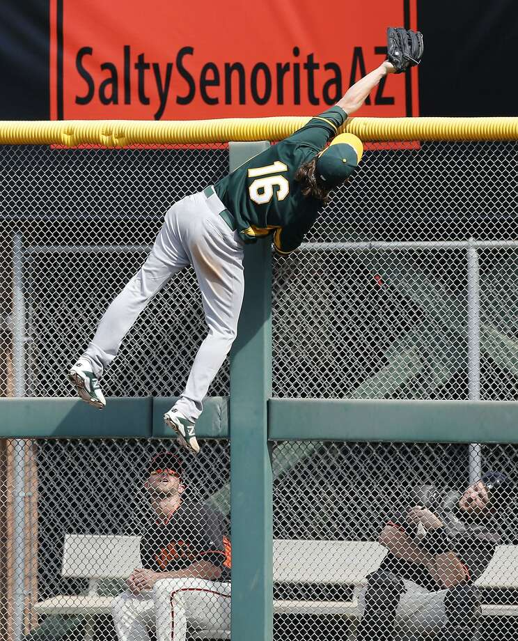 In one of his best catches, Josh Reddick robs the Giants' Michael Morse in the Feb. 26 Cactus League opener. Photo: Michael Macor, The Chronicle