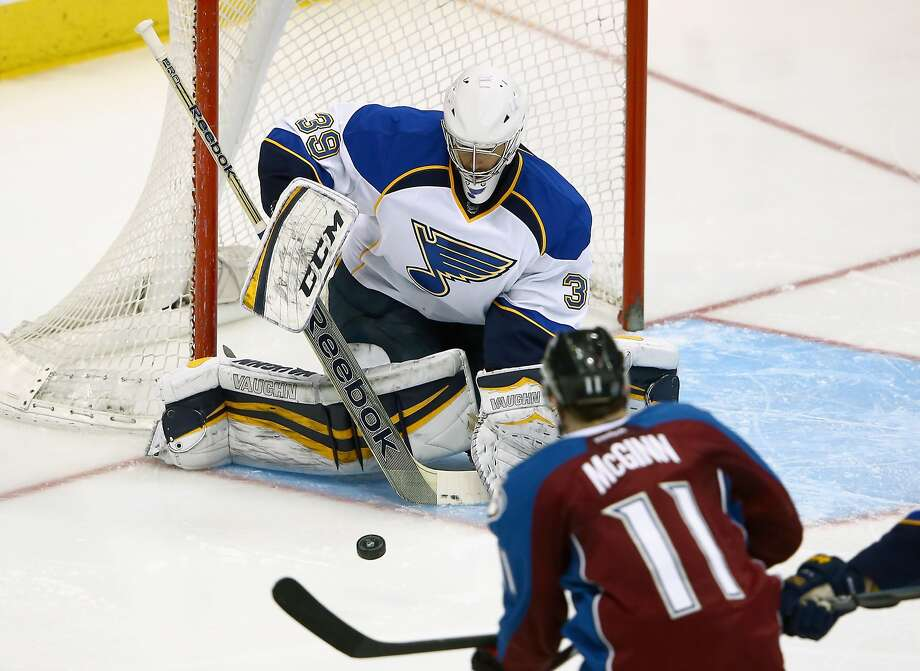 Blues goalie Ryan Miller makes a save against Avalanche forward Jamie McGinn during St. Louis' victory. Photo: Doug Pensinger, Getty Images