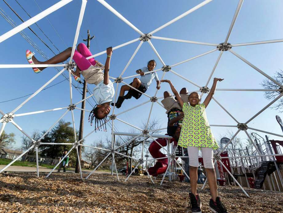 Children enjoy romping on apparatus at Legends PlaySpace on Curtis Street that was built by NBA players during the 2013 All-Star break. The much-used equipment has held up well. Photo: Craig Hartley, Freelance / Copyright: Craig H. Hartley