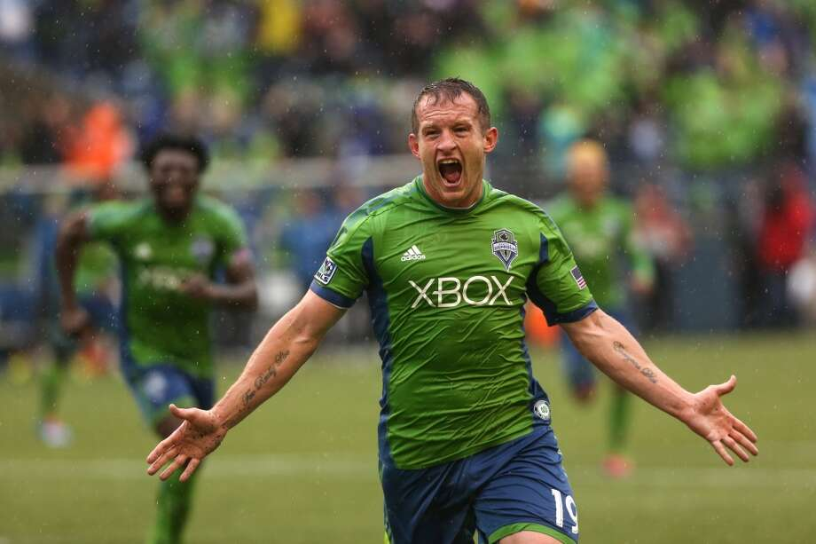 Seattle Sounders player Chad Barrett reacts after scoring a goal against Sporting KC during the final minute of stoppage time during the Sounders season opener on Saturday, March 8, 2014at CenturyLink Field. The Sounders defeated Kansas City 1-0. (Joshua Trujillo, seattlepi.com) Photo: JOSHUA TRUJILLO, SEATTLEPI.COM