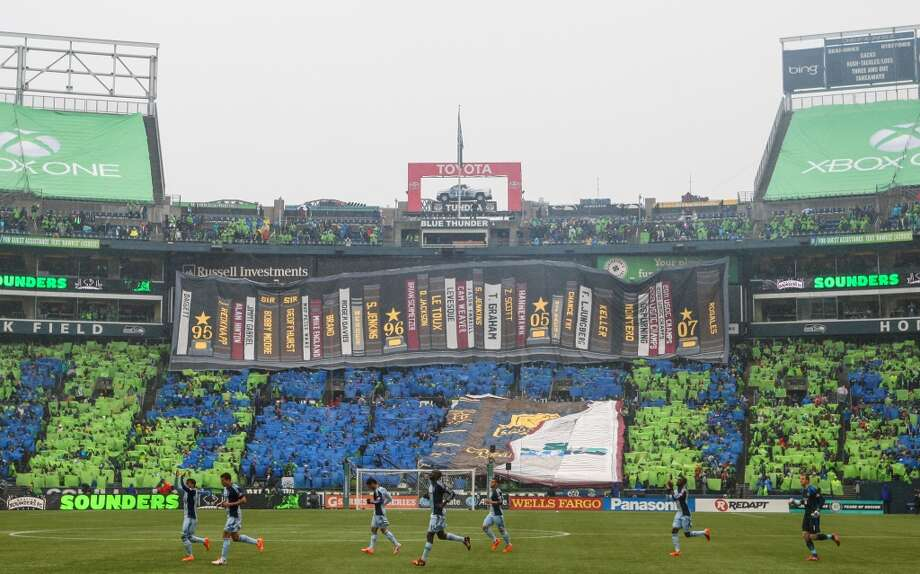 Seattle Sounders fans unveil the season-opening tifo as the season starts against Sporting KC on Saturday, March 8, 2014 at CenturyLink Field. The Sounders defeated Kansas City 1-0. (Joshua Trujillo, seattlepi.com) Photo: SEATTLEPI.COM