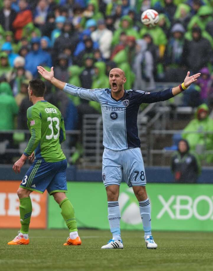 Sporting KC player Aurelien Collin reacts to a play during the Sounders season opener on Saturday, March 8, 2014 at CenturyLink Field. The Sounders defeated Kansas City 1-0. (Joshua Trujillo, seattlepi.com) Photo: SEATTLEPI.COM