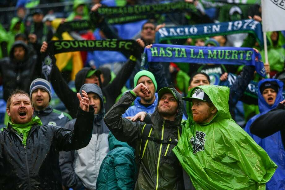 Seattle Sounders  fans cheer for their team against Sporting KC during the Sounders season opener on Saturday, March 8, 2014 at CenturyLink Field. The Sounders defeated Kansas City 1-0. (Joshua Trujillo, seattlepi.com) Photo: SEATTLEPI.COM